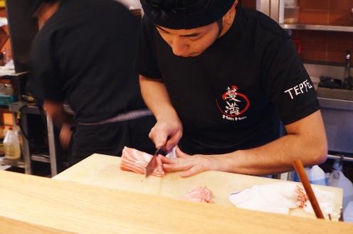Chef cutting toro